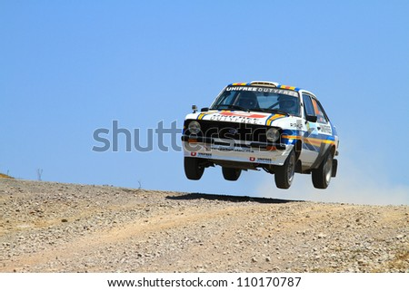 ISTANBUL - JULY 07: Engin Kap drives a Ford Escort Mk2 car during 41st Bosphorus Rally ERC Championship, Halli Stage on July 7, 2012 in Istanbul, Turkey.