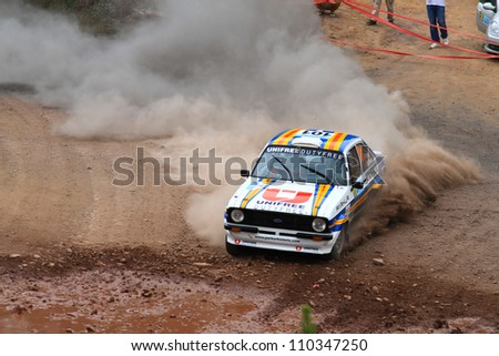 ISTANBUL - JULY 08: Engin Kap drives a Ford Escort Mk2 car during 41st Bosphorus Rally ERC Championship, Halli Stage on July 8, 2012 in Istanbul, Turkey.