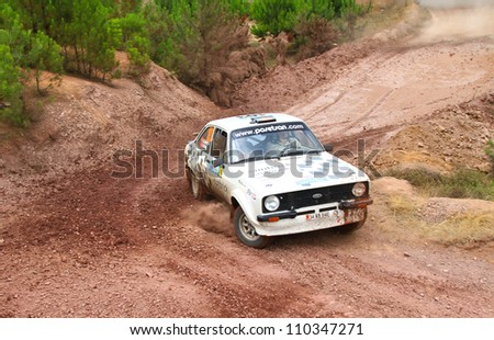 ISTANBUL - JULY 08: Kemal Gamgam drives a Ford Escort Mk2 car during 41st Bosphorus Rally ERC Championship, Halli Stage on July 8, 2012 in Istanbul, Turkey.