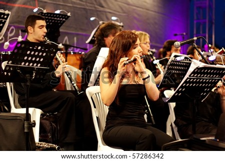 ISTANBUL - JULY 11: Members of the Maltepe Symphonic Orchestra perform live at Maltepe open air stage on July 11, 2010 in Istanbul