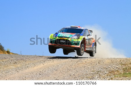 ISTANBUL - JULY 07: Murat Bostanci drives a Castrol Ford Team Turkiye Ford Fiesta S2000 car during 41st Bosphorus Rally ERC Championship, Halli Stage on July 7, 2012 in Istanbul, Turkey.