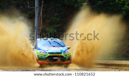 ISTANBUL - JULY 08: Orhan Avcioglu drives a Castrol Ford Team Turkiye Ford Fiesta R2 car during 41st Bosphorus Rally ERC Championship, Deniz Stage on July 8, 2012 in Istanbul, Turkey.