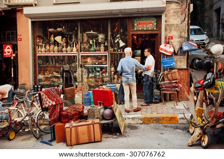 ISTANBUL - 23 JULY: Vintage staff traders meeting near the second hand furniture store with art objects & antiques on July 23, 2015. Cukurcuma of Beyoglu quarter is the city\'s oldest antiques district