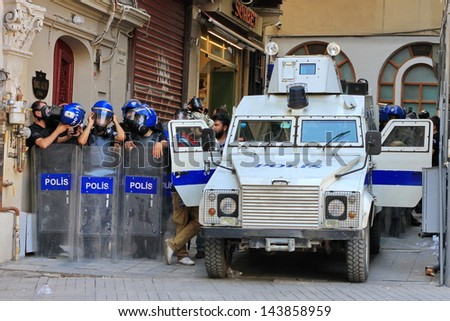 ISTANBUL - JUN 17: Five labor unions call 1-day nationwide strike over crackdown on June 17, 2013 in Istanbul, Turkey. Police team with full equipment wait a dead-end street.