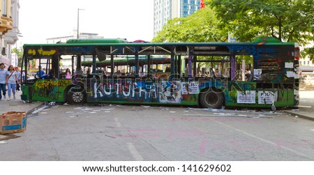ISTANBUL - JUNE 08: Barricade by bus around Taksim Square during protests on June 08, 2013 in Istanbul, Turkey. People do not allow police to enter Taksim Square before their requests are accepted.