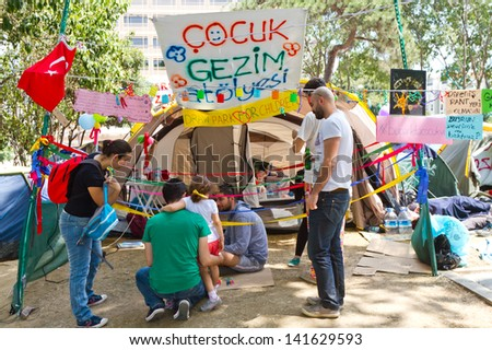 ISTANBUL - JUNE 08: Children workshop tent in Gezi Park on June 08, 2013 in Istanbul, Turkey. Hundreds of people stay in Gezi Parki at night to avoid police intervention.