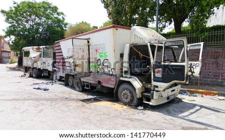 ISTANBUL - JUNE 08: Damaged trucks during protests on June 08, 2013 in Istanbul, Turkey. Police used disproportionate force to protesters at Taksim in first three days. - stock photo
