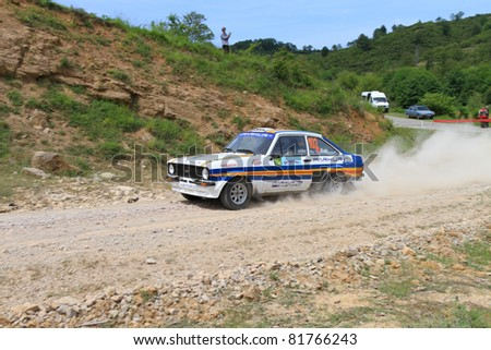 ISTANBUL - JUNE 04: Engin Kap drives a 1979 Ford Escort Rs car during 40th Bosphorus Rally 2011 ER championship, Halli Stage on June 04, 2011 in Istanbul, Turkey