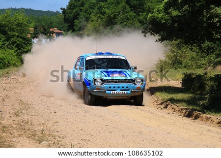 ISTANBUL - JUNE 10: Erdal Tokcan drives a Ford Escort MK1 car during 33th Istanbul Rally championship, ISG Stage on June 10, 2012 in Istanbul, Turkey.