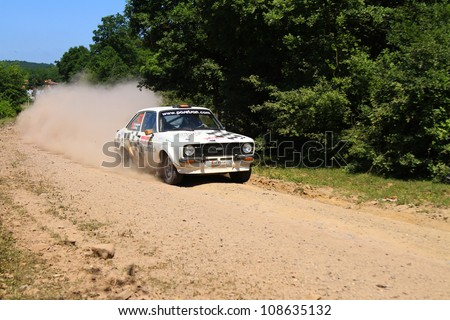 ISTANBUL - JUNE 10: Kemal Gamgam drives a Ford Escort MK2 car during 33th Istanbul Rally championship, ISG Stage on June 10, 2012 in Istanbul, Turkey.
