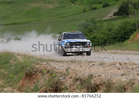 ISTANBUL - JUNE 04: Kemal Gamgam drives a 1979 Ford Escort Rs car during 40th Bosphorus Rally 2011 ER championship, Halli Stage on June 04, 2011 in Istanbul, Turkey