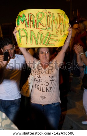ISTANBUL - JUNE 14: Mother of protestor with banner during protests in Turkey on June 14, 2013 in Istanbul, Turkey. They made human chain to protect people from police.