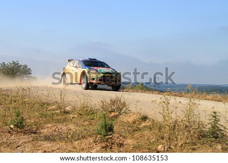 ISTANBUL - JUNE 10: Murat Bostanci drives a Castrol Ford Team Turkiye Ford Fiesta S2000 car during 33th Istanbul Rally championship, Yesilvadi Stage on June 10, 2012 in Istanbul, Turkey.