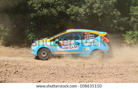 ISTANBUL - JUNE 10: Ozcan Soke drives a Ford Fiesta R2 car during 33th Istanbul Rally championship, ISG Stage on June 10, 2012 in Istanbul, Turkey.