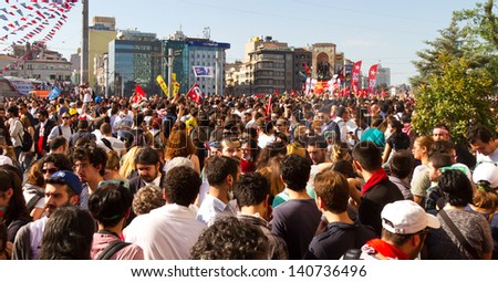 ISTANBUL - JUNE 01: People are at Taksim Square to protest against replacing Taksim Gezi Park on June 01, 2013 in Istanbul, Turkey. Protests developed into antigovernment demonstrations