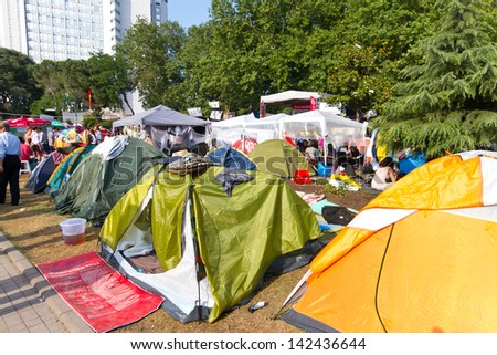 ISTANBUL - JUNE 15: People in Gezi Park during protests on June 15, 2013 in Istanbul, Turkey. Police evacuated Gezi Park by using disproportionate force and clashes until dawn.