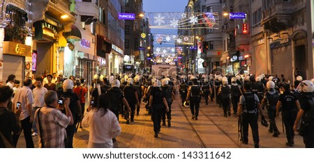 ISTANBUL - JUNE 22: Police intervention to protestors in ����stiklal Street on June 22, 2013 in Istanbul, Turkey. People came Taksim Square with red carnations to commemoration for dead during protests