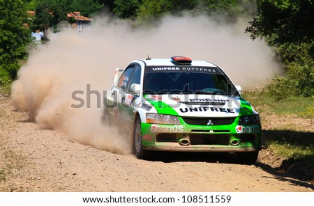 ISTANBUL - JUNE 10: Ugur Soylu drives a Bonus Parkur Racing team Mitsubishi Lancer Evo 10 car during 33th Istanbul Rally championship, ISG Stage on June 10, 2012 in Istanbul, Turkey.