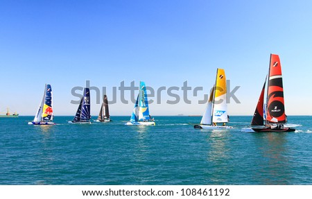 ISTANBUL - JUNE 09: Unidentified participants compete in the Extreme Sailing Series boat race on June 09, 2012 in Istanbul, Turkey.