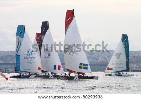 ISTANBUL - MAY 29: Unidentified participants compete in the Extreme Sailing Series boat race on May 29, 2011 in Istanbul, Turkey.