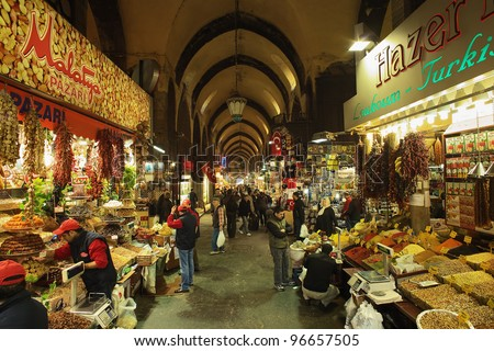 ISTANBUL - NOVEMBER 22: Shopping arcade with spices, nuts and sweets in the Spice Bazaar (Egyptian Bazaar) on November 22, 2011 in Istanbul, Turkey. Spice Bazaar is the oldest bazaar in Istanbul. - stock photo