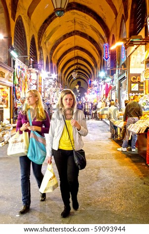 ISTANBUL - NOVEMBER 7: Two young girls in shopping at famous Egyptian Bazaar (Spice Market) on November 7, 2009 in Istanbul, Turkey - stock photo