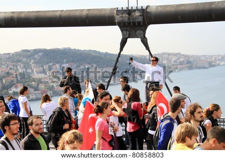 ISTANBUL - OCTOBER 17:  An unidentified man captures himself on the bridge during the 32nd Intercontinental Eurasia Marathon run on October 17, 2010 in Istanbul, Turkey. - stock photo