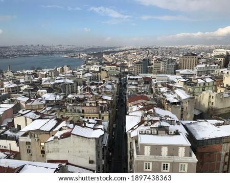 Istanbul's Golden Horn, Galata neighborhood and Buyuk Hendek Street seen from Galata Tower after snow. Stok fotoğraf ©