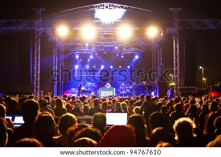 ISTANBUL - SEPTEMBER 18: Pop star Ajda Pekkan performs live during a concert at Maltepe on September 18, 2011 in Istanbul, Turkey. Concert stage and excited spectators are pictured.