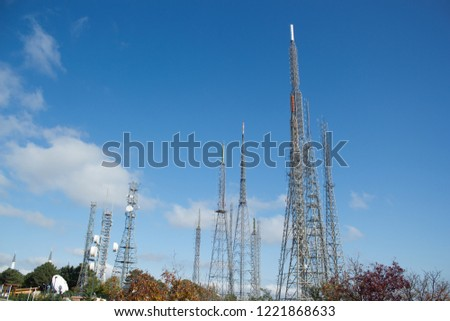 istanbul steel transmitter masts television radio telecommunication towers on camlica hill  broadcasting single frequency network antenna communication mast city silhouette visual pollution  blue sky  #1221868633