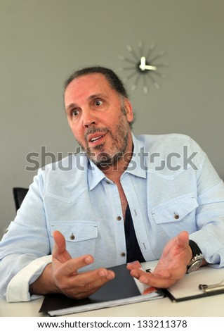 ISTANBUL, TURKEY - APRIL 18: Famous Turkish musician and singer Fatih Erkoc at own album promotion press meeting on April 18, 2012 in Istanbul, Turkey.