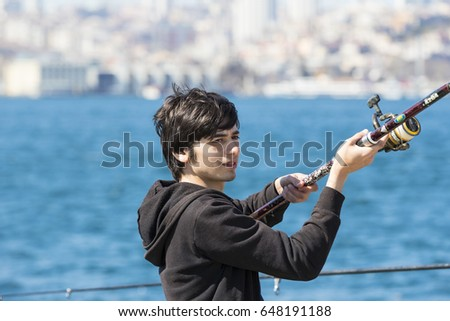 ISTANBUL, TURKEY - 3 APRIL , 2017: Fishermen are fishing on the banks of the Bosphorus in Istanbul Turkey  #648191188