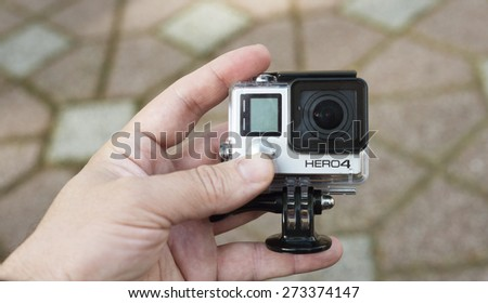 ISTANBUL, TURKEY - APRIL 28 ,2015: Gopro action camera in hand.Shot of GoPro Hero 4 Black.It is a compact, lightweight personal camera manufactured by GoPro Inc.