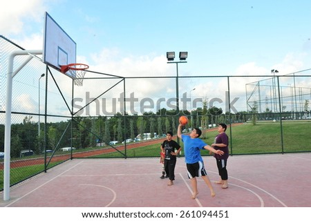 ISTANBUL, TURKEY - AUGUST 12: Children play basketball in the city park on August 12, 2012 in Istanbul, Turkey.