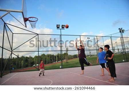 ISTANBUL, TURKEY - AUGUST  12:  Children play basketball in the city park on August 12, 2012 in Istanbul, Turkey.