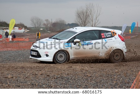 ISTANBUL, TURKEY - DECEMBER 26: Ferhat Tanribilir drives a  Ford Fiesta R2 car during Istanbul Rally Championship, SS Stage on December 26, 2010 in Istanbul, Turkey