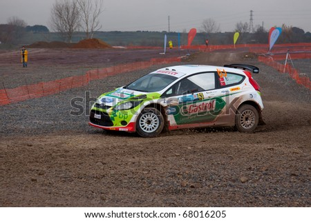 ISTANBUL, TURKEY - DECEMBER 26: Murat Bostanci drives a Castrol Ford Team Turkiye Ford Fiesta S2000 car during Istanbul Rally Championship, SS Stage on December 26, 2010 in Istanbul, Turkey
