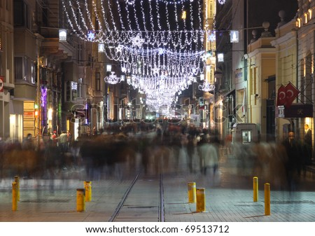 ISTANBUL, TURKEY - DECEMBER 29 : Taksim Istiklal Street at night on December 29, 2009 in Istanbul, Turkey. Taksim Istiklal Street is a popular destination of Istanbul. - stock photo