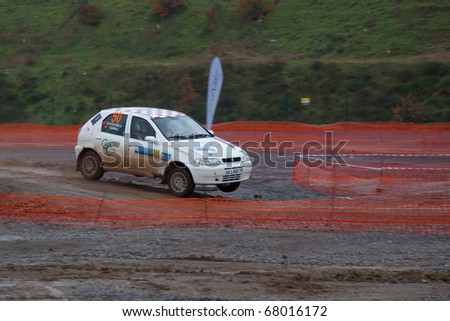ISTANBUL, TURKEY - DECEMBER 26: Yilmaz Can Sanli drives a  Fiat 1.6 Palio car during Istanbul Rally Championship, SS Stage on December 26, 2010 in Istanbul, Turkey