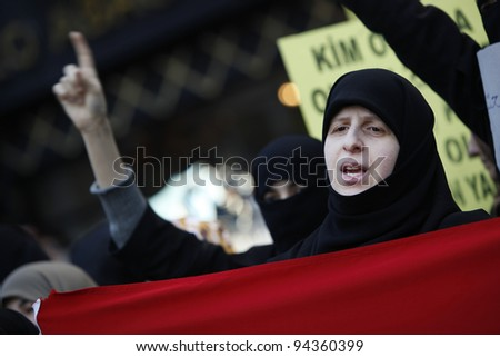 ISTANBUL,TURKEY-FEBRUARY 5:A group of people have staged a demonstration in front of the Syrian Consulate, protesting Syrian authorities' violent crackdown in Homs, on Feb 5, 2012 in Istanbul, Turkey