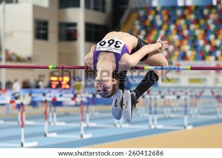 ISTANBUL, TURKEY - FEBRUARY 15, 2015: Athlete Miray Akbulut high jump during Turkcell Juniors and Seniors Athletics Turkey Indoor Championship in Asli Cakir Alptekin Athletics hall