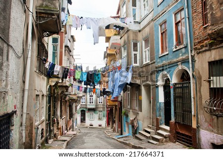 ISTANBUL, TURKEY - JAN 15: Clean clothes drying on a rope between old houses of narrow street of area Tarlabasi on January 15, 2012. Istanbul is located on area of 5,343 sq.km with popul. 13,483,052