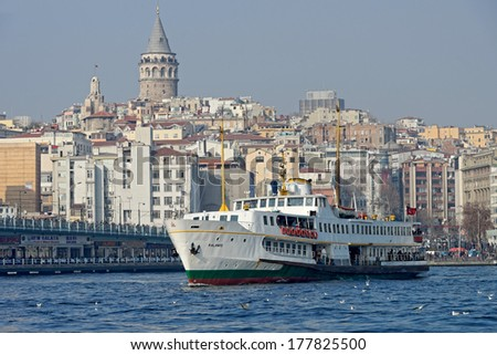 ISTANBUL TURKEY- JAN 12 Cruise ferries in Eminonu Port near Galata Tower and Galata Bridge on January 11 2014 in Istanbul Turkey The Eminonu waterfront is a major dock for ferryboats in Istanbul
