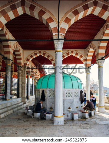 ISTANBUL TURKEY JANUARY 19 2015 Mihrimah Sultan Mosque in Uskudar District People who take ablution at Mihrimah Sultan Mosque in istanbul on JANUARY 19 2015 in Istanbul Turkey