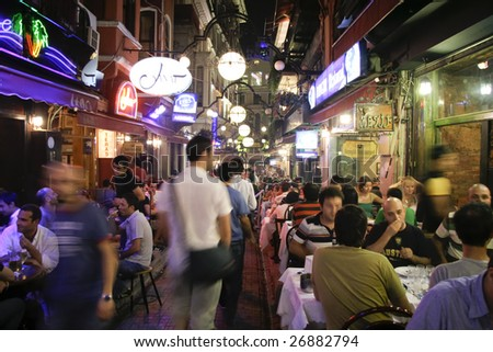 ISTANBUL, TURKEY - JULY 25 : Busy restaurant and bar scene at night in Taksim, Istanbul, Turkey on July 25, 2007. Taksim is a popular destination for tourists and locals of Istanbul.
