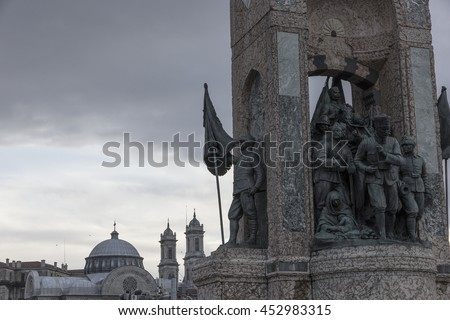 ISTANBUL, TURKEY- JULY 16TH 2016: The statue of the Turkish army of Ataturk on Taksim square, Istanbul, Turkey. In the background there is a muslim mosque. An illustrative editorial image.