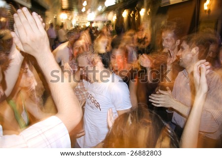 ISTANBUL, TURKEY - JULY 25 : Turkish youth enjoying dancing in the streets of Taksim in Istanbul, Turkey on July 25, 2007. Taksim is a popular destination for tourists and locals of Istanbul. - stock photo