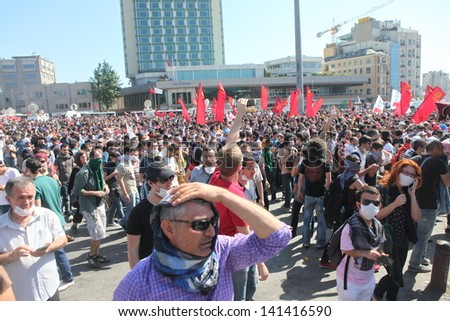 ISTANBUL,TURKEY-JUN E 1: Protesters in Taksim continue as minor scuffles break out and protesters lob fireworks at officers. Police removed barricades around the square on June 1,2013 in Istanbul.