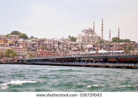 ISTANBUL, TURKEY - JUNE 03: Cruise ferries in Eminonu Port near Yeni Cami and Galata Bridge on June 03, 2012 in Istanbul, Turkey. Nearly 150,000 passengers use ferryboat daily in Istanbul.