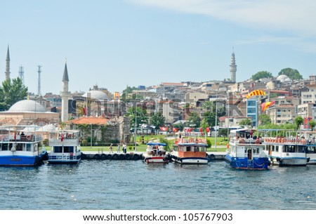 ISTANBUL, TURKEY - JUNE 03: Cruise ferries in Eminonu Port near Yeni Cami on June 03, 2012 in Istanbul, Turkey. Nearly 150,000 passengers use ferryboat daily in Istanbul.